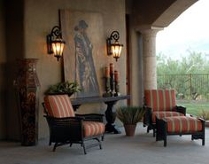This award-winning design by Sandra Keeney brings the comforts of the indoors to a cozy outdoor seating area, shaded from the sun. Those striped cushions and cheerful lanterns make this area feel inviting day or night.