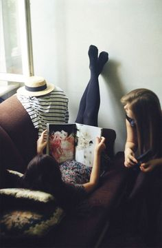 Lazy rainy days spent #indoors.  -reading, looking at pictures, and being with friends are nothing but Smiles.