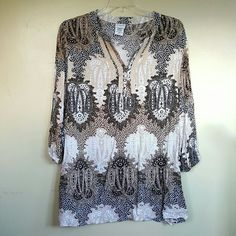 """Jaclyn Smith Tunic Black, white, tan print. Slight V neck. 3 button detail. 100% rayon. Great condition.  Elastic at end of sleeves. Almost 32"""" in length. Underarm to Underarm is 24"""". Jaclyn Smith Tops Tunics"""