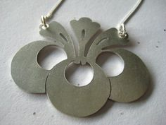 This artist has many beautiful saw pierced pieces.  Gorgeous-check her out on Etsy