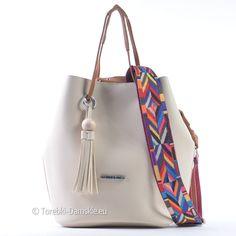 Torebka w jasnym odcieniu beżu (ecru - kremowy) z azteckim kolorowym paskiem regulowanej długości. Zobacz http://torebki-damskie.eu/ecru/1512-torebka-jasnobezowa-ecru-z-kolorowym-azteckim-paskiem.html