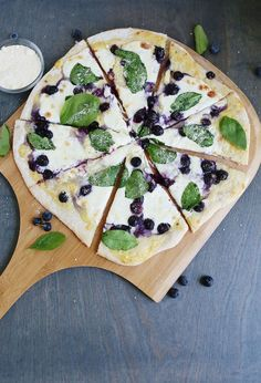 Blueberry spinach pizza with creamy white sauce