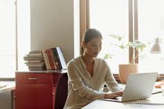 Stock Photo : Business woman at working on laptop