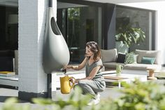 The drop-shaped apparatus attaches to drainpipes, while an integrated watering can collects water directly from the pipe when it rains.