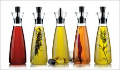 Essential Kitchen Tools - 11 Beautiful Oil & Vinegar Dispensers | Tall oil dispensers like these are perfect for adding herbs and other things to infuse your oil at home and makes the display much nicer to look at.