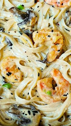 Creamy Shrimp and Mushroom Pasta in a Delicious Homemade Alfredo Sauce ~ This creamy alfredo sauce has all the flavors you want and need... shrimp flavor, garlic, basil, crushed red pepper flakes, paprika, Parmesan and Mozzarella cheese.
