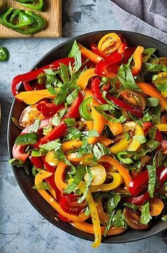This sweet and tangy salad is chock full of peppers, onions, tomatoes and spinach that have been marinated in a mixture of toasted cumin seeds, lime juice and honey. It's the perfect addition to your next taco night. #salads #saladrecipes #healthysalads #saladideas #healthyrecipes