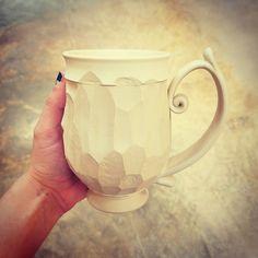 New textured mug style and I am in LOVE! #woodtexture #woodtexturedmug #carvedmug #carving #kaiceramics #kaitlynceramics #mudfire #madeatmudfire #mugs #porcelainmugs #handmademugs #swirlhandlemugs #swirlhandle #swirl #vinehandle #different