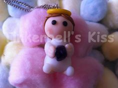 Μικρός άγγελος με πέτρα αμέθυστου στην αγκαλιά του.    Code: C4