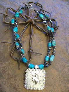 Absolutely gorgeous beaded concho necklace with genuine turquoise and hematite beading. $45