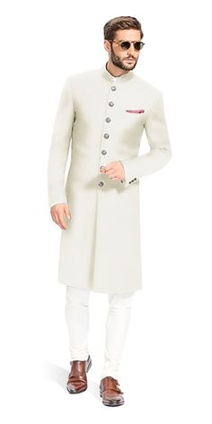Gurhkan Off White This Off White Achkan is designed to be comfortable and elegant. It is made with the finest Italian fabrics from Vitale Barberis Canonico. Indian Wedding Suits Men, Sherwani For Men Wedding, Mens Indian Wear, Mens Ethnic Wear, Sherwani Groom, Mens Sherwani, Wedding Dress Men, Indian Men Fashion, Mens Fashion Suits