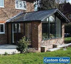A beautiful Custom Glaze garden room extension that has become an integral part of the home, giving the customer a large lounge area in the kitchen/dinning room. Beautiful, tall, gable end windows allow undisturbed views of the garden. A bi-fold door and Conservatory Ideas Sunroom, Modern Conservatory, Conservatory Kitchen, Conservatory Interiors, House Extension Plans, House Extension Design, Extension Designs, Rear Extension, Living Room Extension Ideas