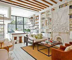 Love this room's coffee table, exposed beams, color palette, etc., etc., etc...