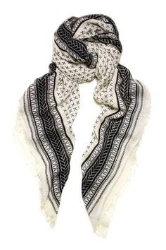 Zar Scarf by A Peace Treaty. Hand screen-printed scarf in ecru, with basket weave borders and small X pattern in black. Artisans in India hand cut screens of APT's complex patterns and print them on soft and luxurious handwoven scarves.