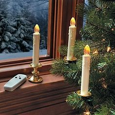 "Remote Control Flickering LED Candles - Improvements by Improvements. $29.98. These battery-powered candles have a ""drip"" design candlestick and stylish brass-look base. Remote Control Flickering LED Candles can be clipped to tree, attached to window, or placed on table or windowsill. Remote control turns all 8 battery-operated candles on or off at same time. Remote control turns all 8 battery-operated candles on or off at same time. Remote Control Flickering LED Can..."