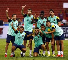 Barcelona players celebrates the end of training session during a Barcelona FC training session at Bukit Jalil National Stadium on August 9, 2013 in Kuala Lumpur, Malaysia.