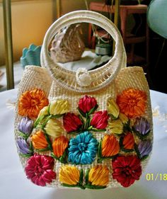Hey, I found this really awesome Etsy listing at https://www.etsy.com/listing/190087849/vintage-raffia-handbag-with-mult-colored