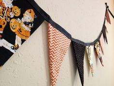 A Nostalgic Halloween Fabric Pennant Banner in Black and Orange with Vintage prints, Gingham, Polka Dots, and Chevron. Retro Halloween. Sweet October, via Etsy.