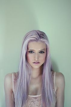 Creative. I love the hair color and brow, make-up look all together.