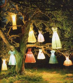 They are not dress forms,but wouldn't it be awesome to see dress form lamps? Tim Walker, The Dress Lamp Tree, England 2002.