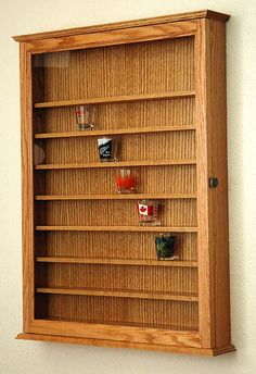 Tad likes this for his shotglass collection: 72 Oak Shot Glass Display Case Wall Cabinet Shelf Rack | eBay