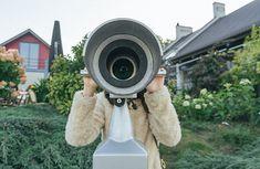 Girl Looking Through a Binoculars.   by Luis Velasco for Stocksy United