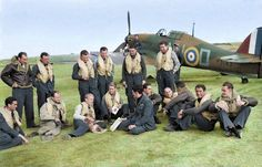 Czechoslovak pilots of No. 310 (Czechoslovak) Squadron RAF and their British flight commanders grouped in front of Hawker Hurricane Mark I, P3143 'NN-D', at Duxford, Cambridgeshire