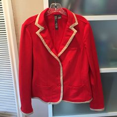 """European designer jacket, like new! This is an incredibly comfortable soft red jacket with khaki trim. The material is 74% polyester 23% viscose 3% spandex.  Jacket will move with your figure because of the spandex.  Cute red buttons on sleeves.  Kakhi trim around bottom of jacket.  Fashionable slit in back for increased movement.   This is a truly superb jacket.   I'd keep it but it doesn't fit me.  It's in excellent like new condition.  Length is 26"""". Chest is 18"""". Arms are 26"""".  JACKET…"""