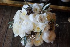 A lovely November bridal bouquet with peonies, olive branches & more.