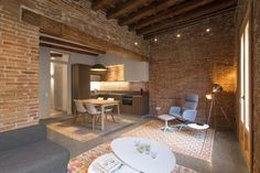Contemporary flat in Barcelona's Eixample defined by the Catalan hydraulic cement tiles and exposed brick walls and the wooden beamed ceilings - CAANdesign | Architecture and home design blog