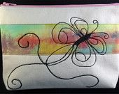 Medium sized zipped pouch with free machine embroidered design