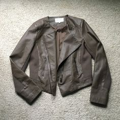 Just Fab Moto Jacket Brand new, never worn Just Fab moto jacket in the color taupe.   ✨Brand new and never worn✨ Tags not included Only $12 for a LIMITED time JustFab Jackets & Coats