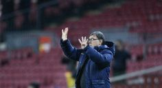 FC Barcelona's coach Gerardo Tata Martino, from Argentina, gestures during a Copa del Rey soccer match against Elche at the Camp Nou sta...
