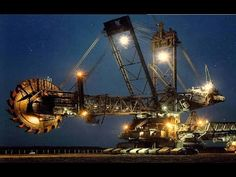 Bagger 293 is the world's largest bucket-wheel excavator built in Germany in It is about 315 foot tall , 750 foot long and w. Mining Equipment, Heavy Equipment, Armored Truck, Tonka Toys, Large Bucket, Industrial Machine, Road Train, Heavy Machinery, Coal Mining