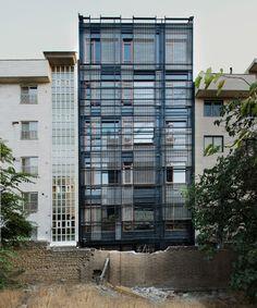 peyman meydani   behzad ayati weave narenjestan building's linear facade - designboom | architecture