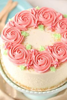 """This Raspberry Almond Layer Cake has three layers of moist, fluffy almond cake filled with fresh raspberry frosting! So there was a moment this past weekend where I realized what true love really is. It's giving your spouse the """"best"""" pillow even when you want it. Let me explain. We were visiting my parents and …"""