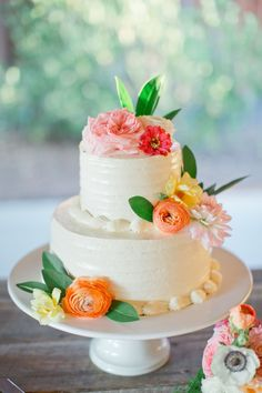 Beautiful wedding cake by Gloriosa Design  | See more of the wedding on SMP: http://www.StyleMePretty.com/southeast-weddings/2014/03/05/colorful-southern-wedding-in-palmetto-georgia/ Harwell Photography