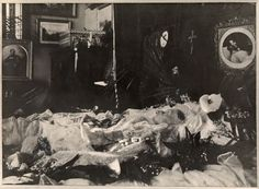 Queen Victoria's deathbed, overlooked by a picture of Prince Albert on his deathbed