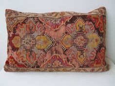 Very old and Antique handmade carpet pillow case -from eastern anatolia.    http://www.etsy.com/listing/87758321/turkish-very-old-and-antique-wool-carpet