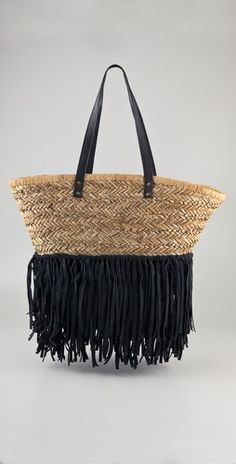 Really cute...Malene Birger leather fringe straw tote.