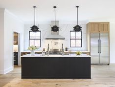 Two-toned, gourmet kitchen designed by Arianne Bellizaire Interiors featuring Zephyr hood, Brizo faucets and Top Knobs hardware Gourmet Kitchen Design, House Renovation Projects, Cabinetry Design, Louisiana Kitchen, Home Reno, House, Kitchen Design, Cabinetry, Luxury Homes
