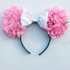 These ears are made using pink silk roses and complimented with a white bow. Ears are securely placed onto a ribbon wrapped headband. xoxo. One size fits young kids-adults