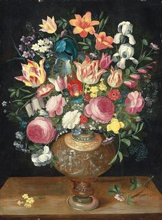 """dutch-and-flemish-painters: """"Andries Daniels & Frans Francken II - A still life of flowers in a sculpted vase - Andries Daniels (c. 1580 – after 1640) was a Flemish painter of flower still lifes who played an important role in the development of the..."""