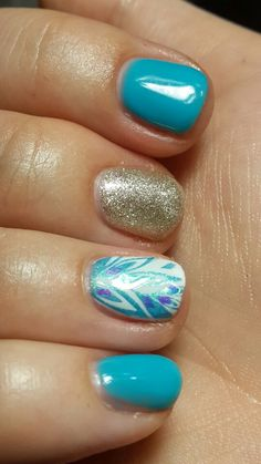 Love this one! Blue and gold stamp nail art gel nails
