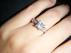 I like how the band has round diamonds and would like to see the main diamond round too ...Engagement Ring