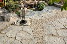 Landscape Plus LLC installs patios with garden ponds, waterfalls, fountains and pondless waterfalls.