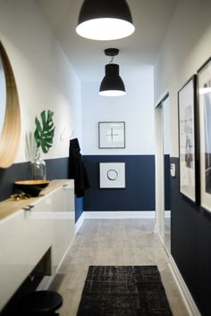 navy blue home accents Long condo entryway with navy blue lower half walls Condo Design, Nest Design, House Design, Interior Design, Design Design, Blue Hallway, Long Hallway, Hallway Paint, Hallway Colours