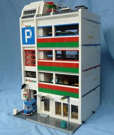 It amuses me that the lego Octan fuel brand still exists even with the same brand colors! This is a modular multi-level parking garage by Antoine Potten on Mocpages.com . . . . Live links to original posters pages are in the gallery on my web site (often a few days behind IG). Link in bio. #LEGO #LEGOarchitecture #Legobuilding #Legohouse #legophotography #legostagram #legos #legoideas #legophoto #lionsgatemodels #legomania #legomoc #instalego #legocity #afol #legotown #legomodular…
