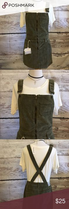 NWT olive corduroy overall dress New with tags size small. Perfect for fall and winter. A little stretchy so could fit a smaller medium as well. Adjustable straps Dresses Mini