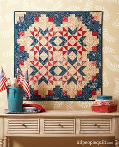 Fireworks Stars shine on a patriotic wall hanging that's packed with nostalgic charm. Get the free quilt pattern here.